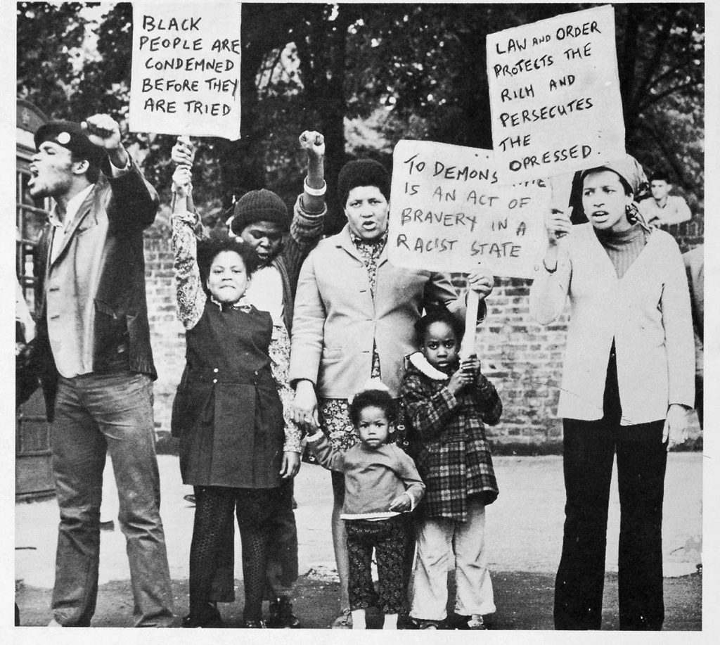 Black families with placards at the protest march