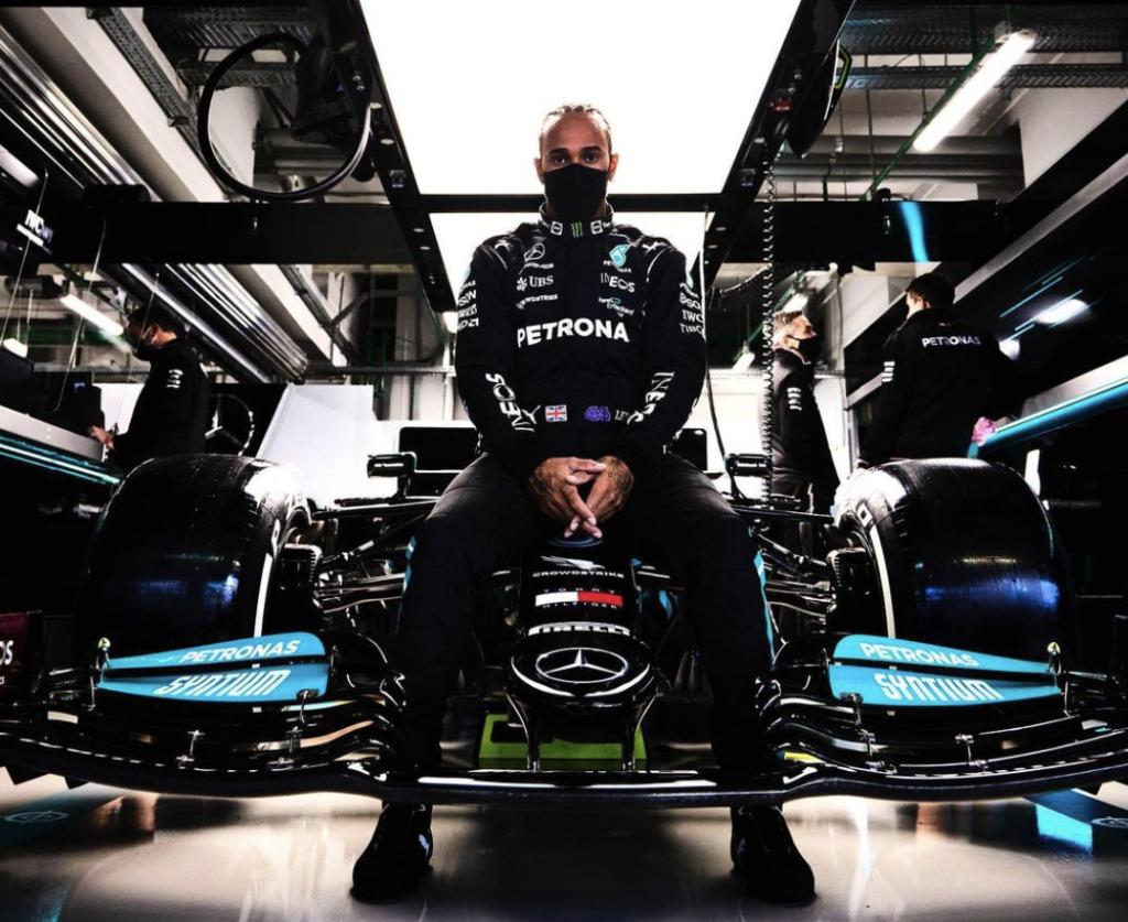 Lewis Hamilton Poses with his car